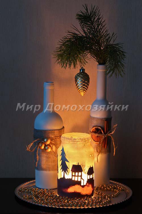 Композиция из белых бутылок и свечи в банке